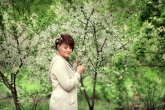 Woman in blooming garden Royalty Free Stock Photos