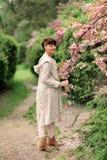 Woman in blooming garden Stock Image