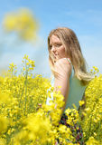 Woman on blooming rapeseed field Royalty Free Stock Images