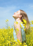 Woman on blooming rapeseed field Stock Photography
