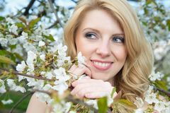 Woman with Blossoms Stock Photo