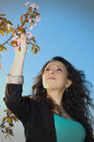 Woman and blossoms Stock Photography