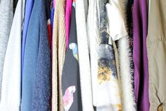 Woman blouse hanging in the closet. Group of blouses hung for a long time, with dust, in the closet stock photography