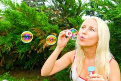 Woman blow bubbles Stock Photos