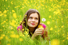 Woman blow on dandelion Stock Photography