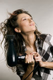 Woman blow-dry her hair Stock Photos