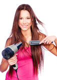 Woman blow dryer and comb Royalty Free Stock Photos