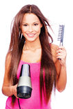 Woman blow dryer and comb Stock Photography