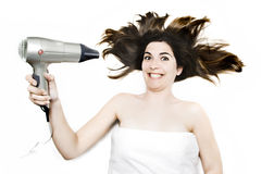 Woman Blow Drying Hair Royalty Free Stock Image