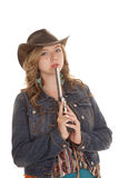 Woman blow on gun western hat Stock Photography