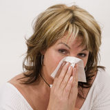 Woman blow one's nose Royalty Free Stock Image