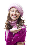 Woman blow snowflakes from palm Royalty Free Stock Images