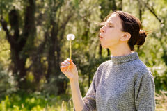 Woman and Blowball Dandelion Royalty Free Stock Photo