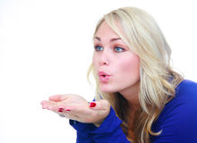 Woman blowing air over hands. Royalty Free Stock Image