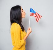 Woman blowing on american flag Royalty Free Stock Images