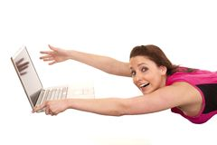 Woman blowing away from laptop Royalty Free Stock Photos