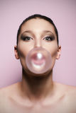 Woman blowing a big bubble gum bubble Royalty Free Stock Photo