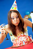 Woman blowing birthday candles Royalty Free Stock Photography