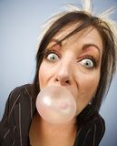 Woman blowing a bubble Royalty Free Stock Photos