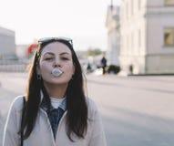 Woman Blowing A Bubble Stock Photos