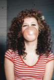 Woman blowing bubblegum Royalty Free Stock Images