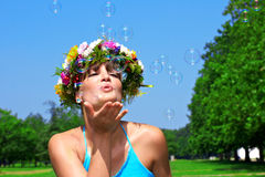 Woman blowing bubbles Royalty Free Stock Photos