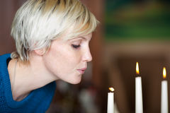 Woman Blowing Candle In Restaurant stock photo