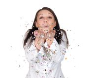 Woman blowing confetti Stock Image