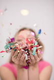 Woman blowing confetti in the air Stock Photos