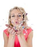 Woman blowing confetti Stock Photo