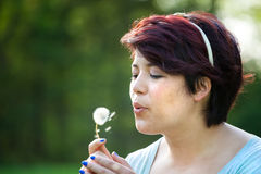 Woman Blowing Dandelion Stock Photography