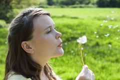Woman Blowing Dandelion Seeds Royalty Free Stock Photo