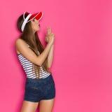 Woman Blowing At Finger Gun royalty free stock photography