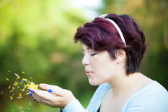 Woman Blowing Flower Petals Stock Photography