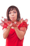 Woman blowing heart Stock Image
