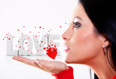 Woman blowing hearts Royalty Free Stock Photography