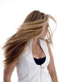 Woman blowing her hair. With white background Royalty Free Stock Photography
