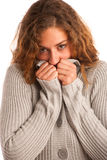 Woman blowing in her hands when feeling cold Stock Photography