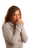 Woman blowing in her hands when feeling cold Stock Photos
