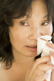 Woman Blowing Her Nose Stock Photography