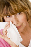 Woman Blowing Her Nose Royalty Free Stock Photos