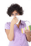 Woman blowing her nose at tissue Royalty Free Stock Photos
