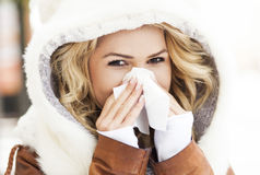 Woman blowing her nose Stock Photo
