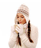 Woman blowing hot chocolate Royalty Free Stock Photography