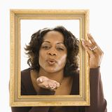 Woman blowing kiss. Royalty Free Stock Photography