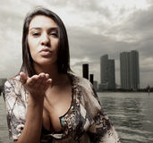 Woman blowing a kiss Stock Images