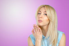 Woman blowing a kiss. Blonde woman blowing a kiss Stock Photo