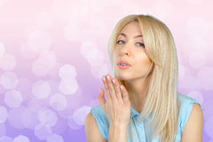 Woman blowing a kiss. Blonde woman blowing a kiss Stock Images
