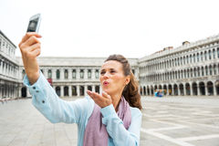 Woman blowing kiss and making selfie  in venice Stock Photography