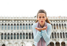 Woman blowing kiss on piazza san marco in venice Stock Photo